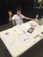 Son Jamison doing commissions at con Comic Art